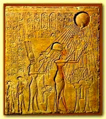 From right to left, Akhenaten, Nefertiti, Meritaten, and an unknown figure (a second daughter of Akhenaten's?) raise their arms in supplication to the Aten